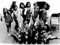1975 womens team shows their muscles.png